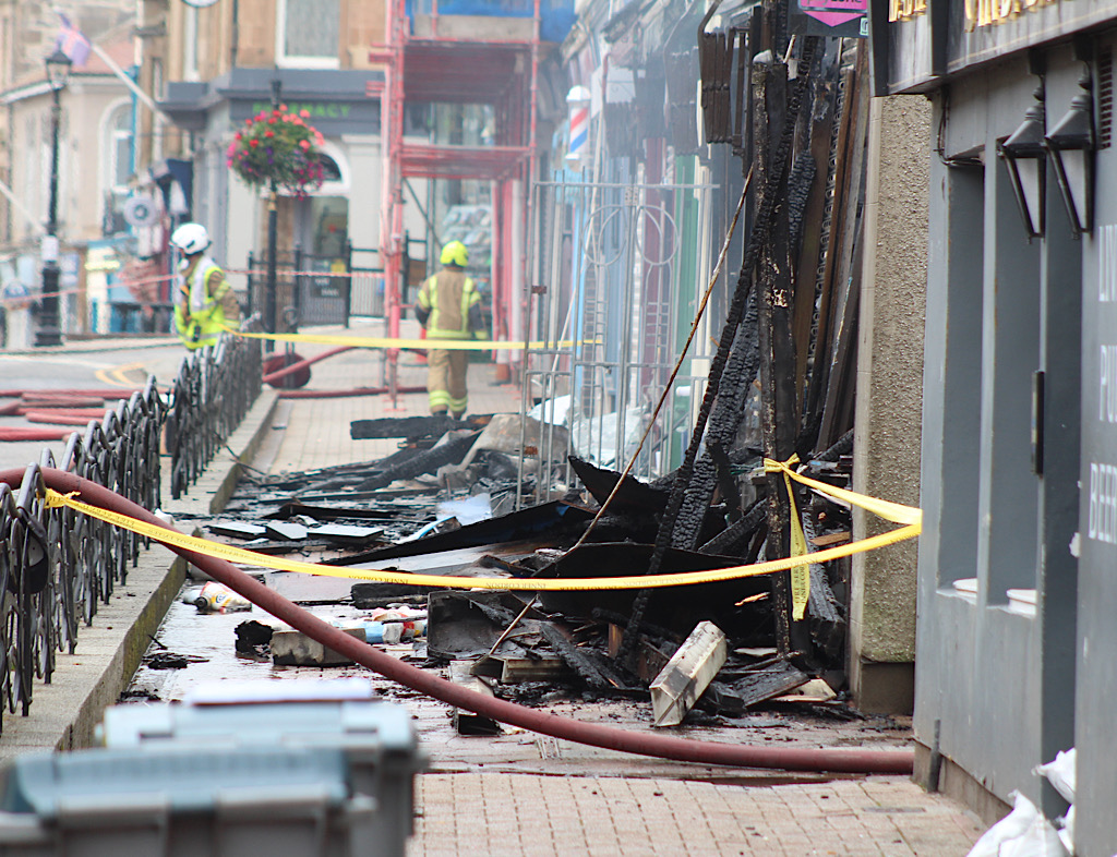 Two charged after town centre fire
